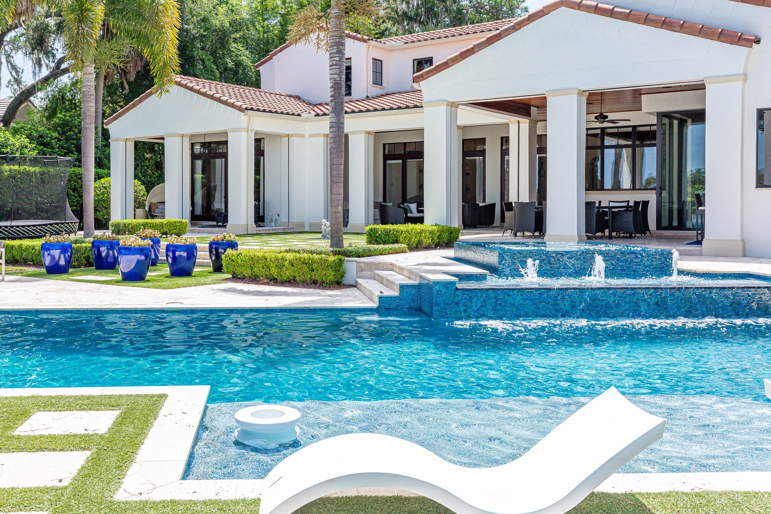 beautiful backside exterior and pool of custom home built by Einheit home builders