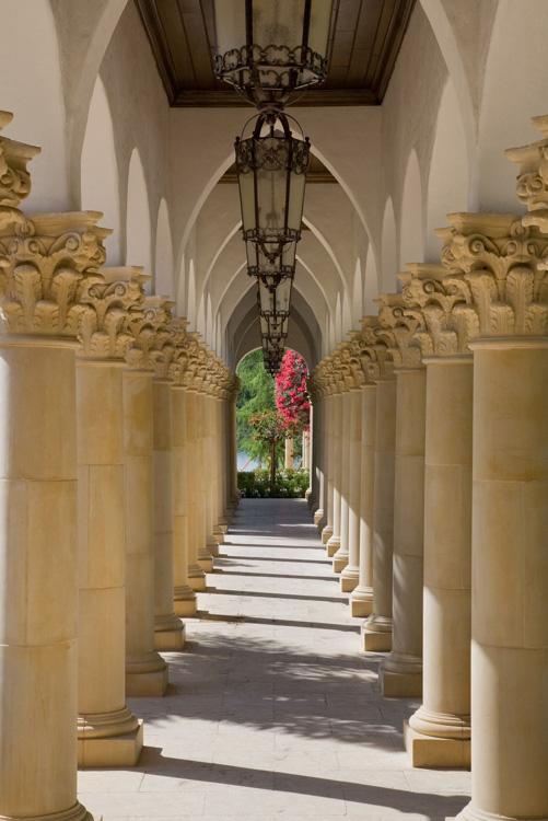 gorgeous hallway of stone pillars built by Einheit custom homes