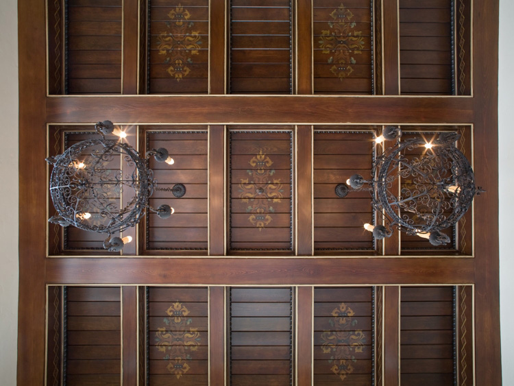 ornate wooden ceiling design with chandeliers built by the Einheit Company