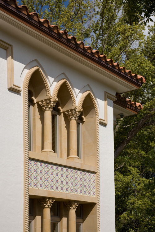 intricate stone window details on custom home built by Einheit Homes in Orlando