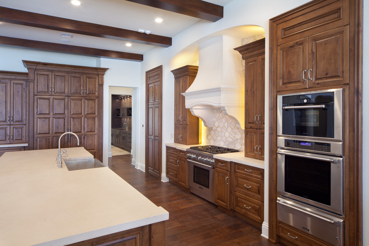 custom kitchen in remodeled home by Einheit Homes