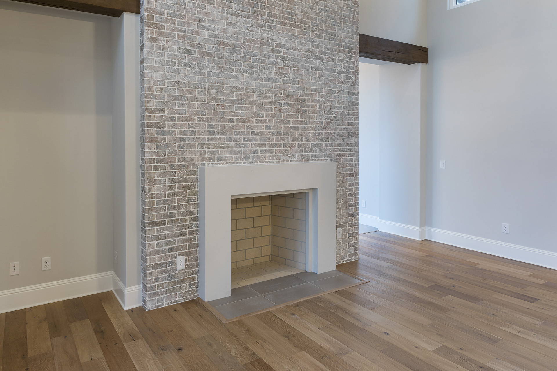 new fireplace designed and built by Einheit custom homes