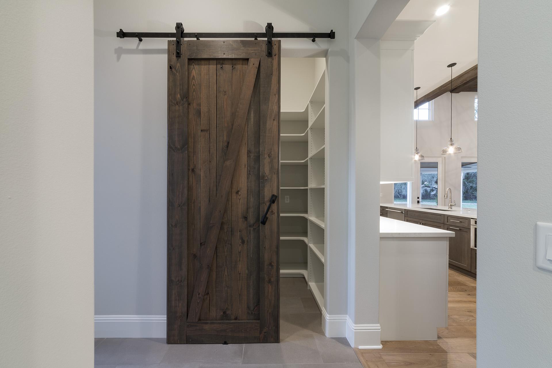 custom wooden sliding door in remodeled home by Einheit Homes