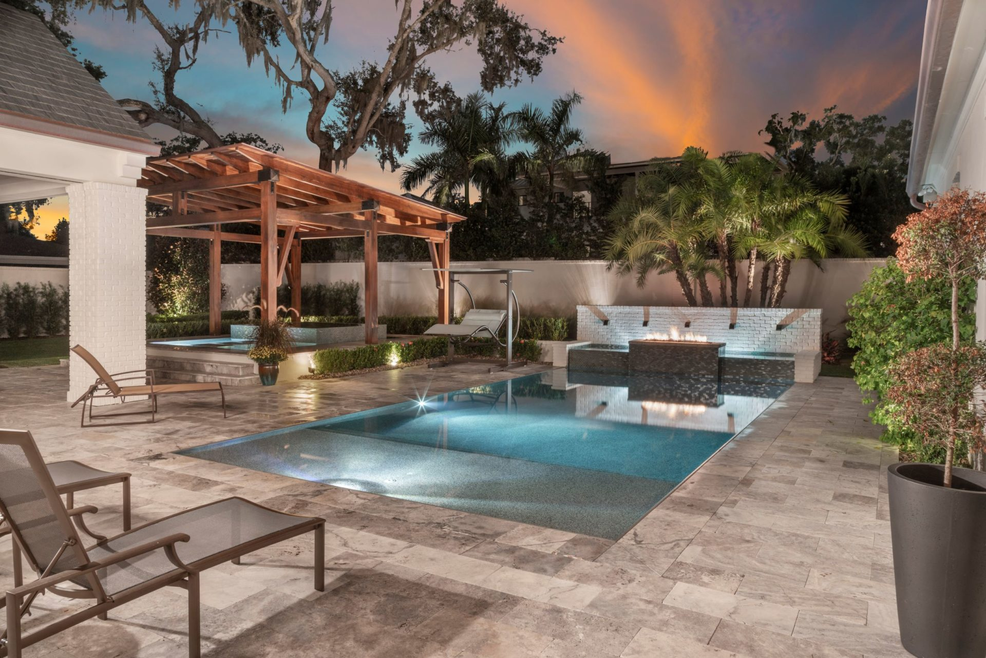 gorgeous backyard with pool designed and built by Einheit custom home builders