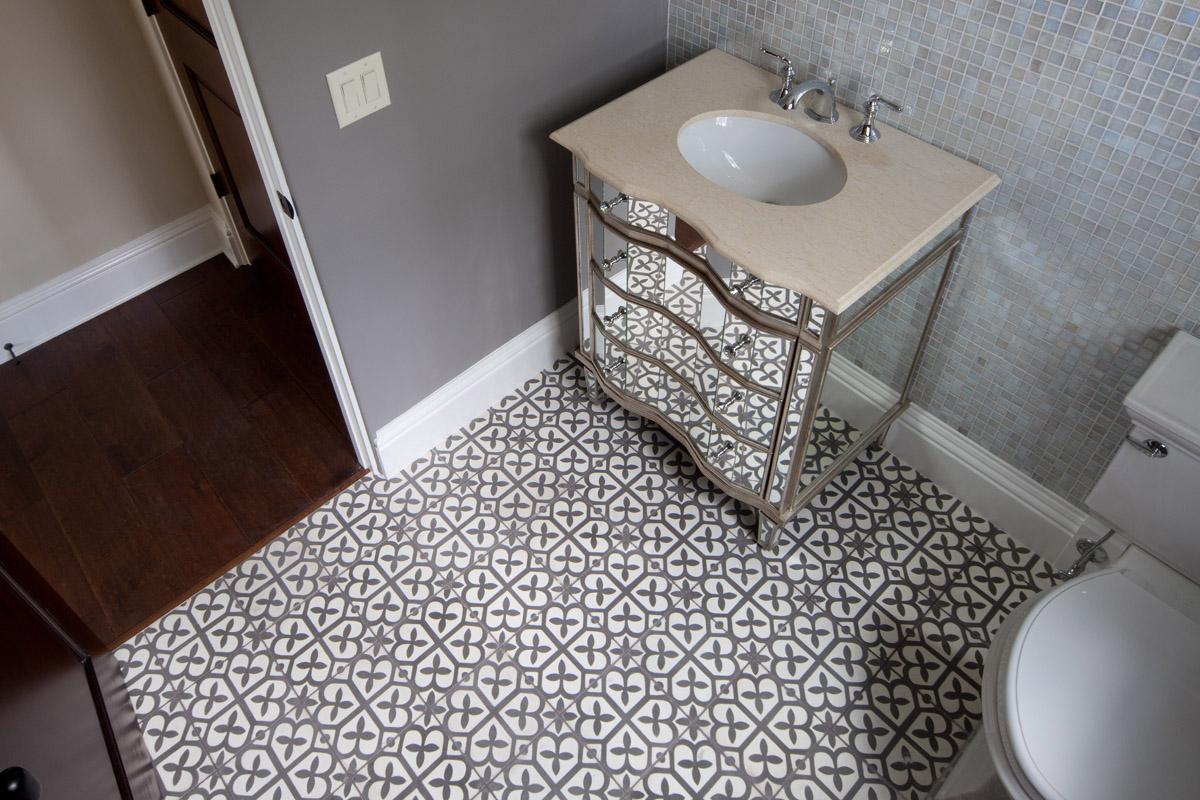 ornate bathroom floor by Einheit Homes, an Orlando custom home builder
