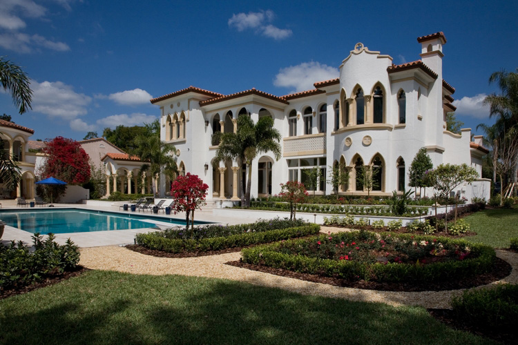 exterior of custom home with pool and garden built by Orlando custom home builder Einheit Homes