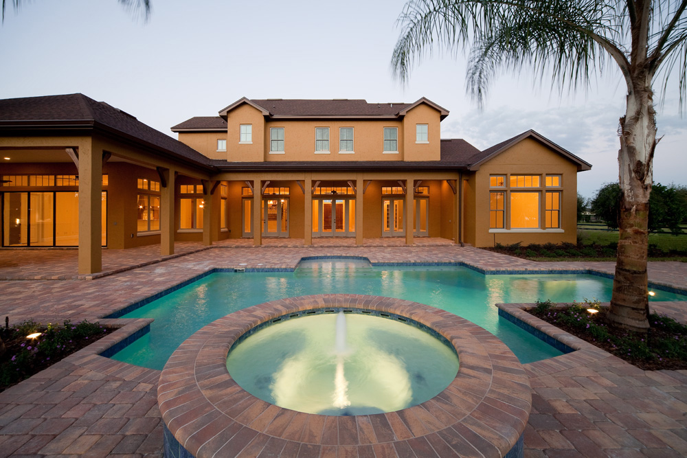 custom pool and fountain built by custom home builder Einheit Homes