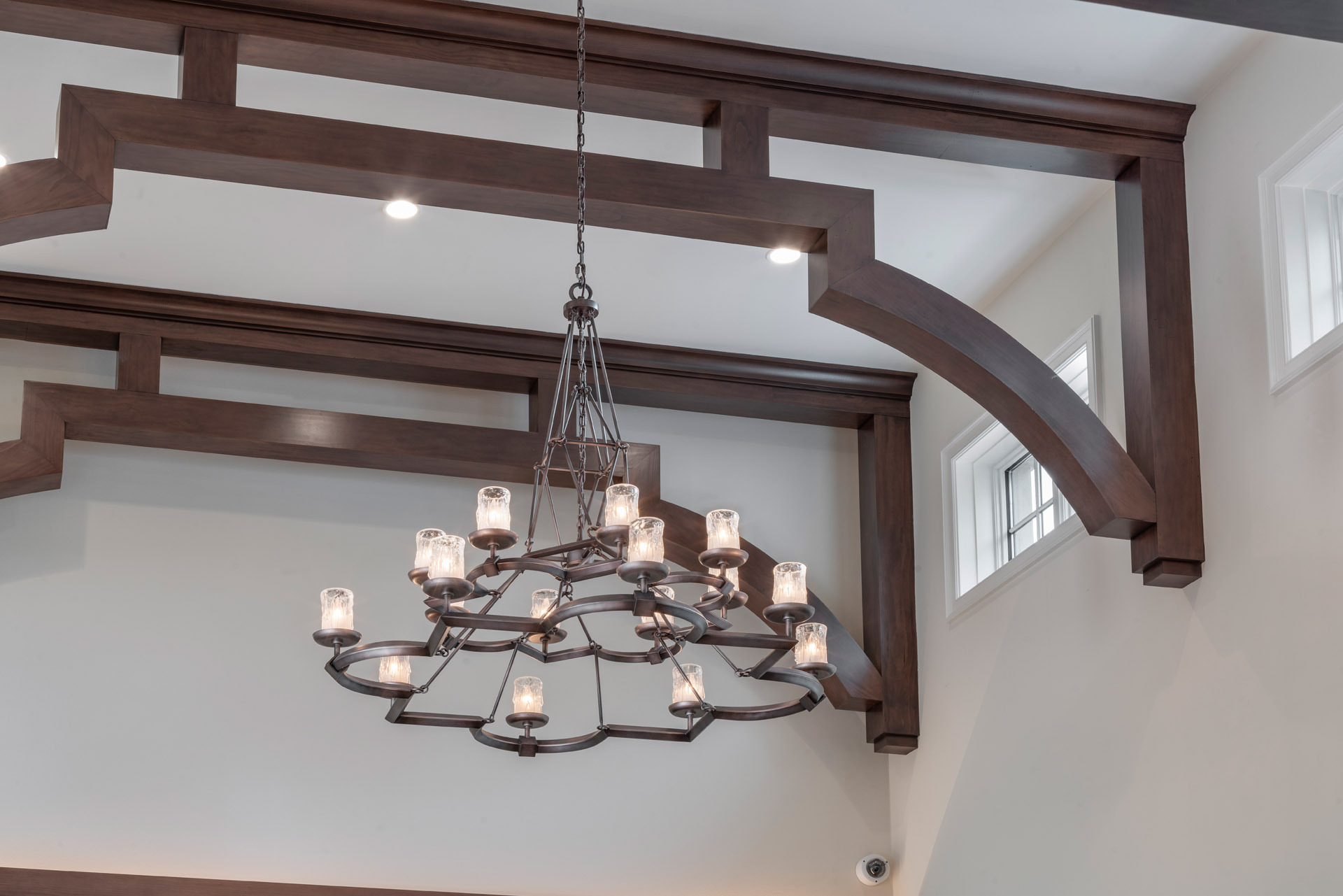 elegant wooden ceiling beams and chandelier by Einheit custom homes