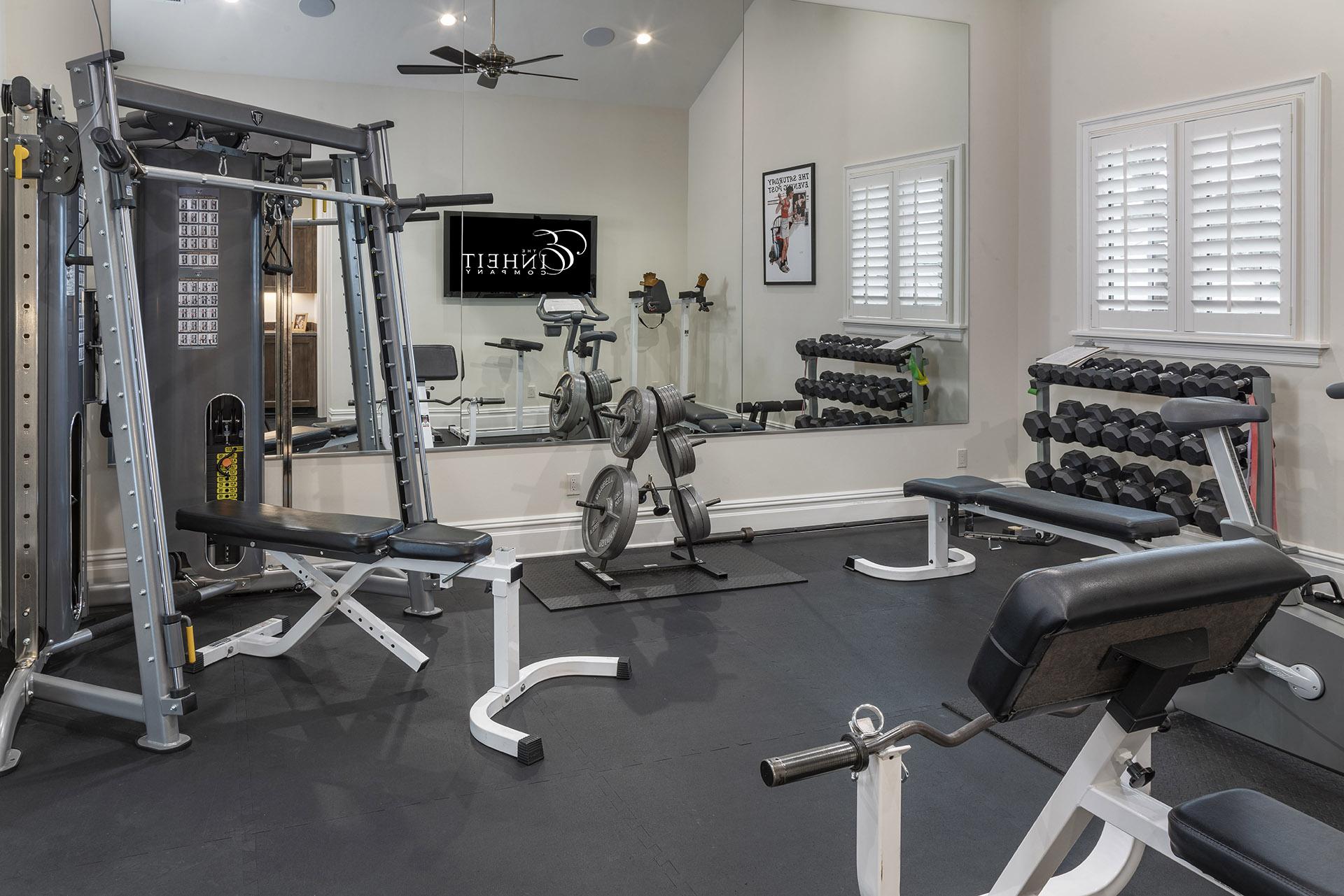 custom home gym designed and built by Einheit custom home builders