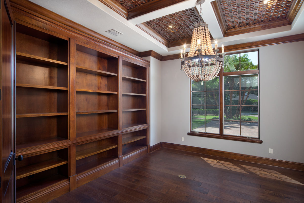 custom wood shelving in whole home remodel by Einheit Homes